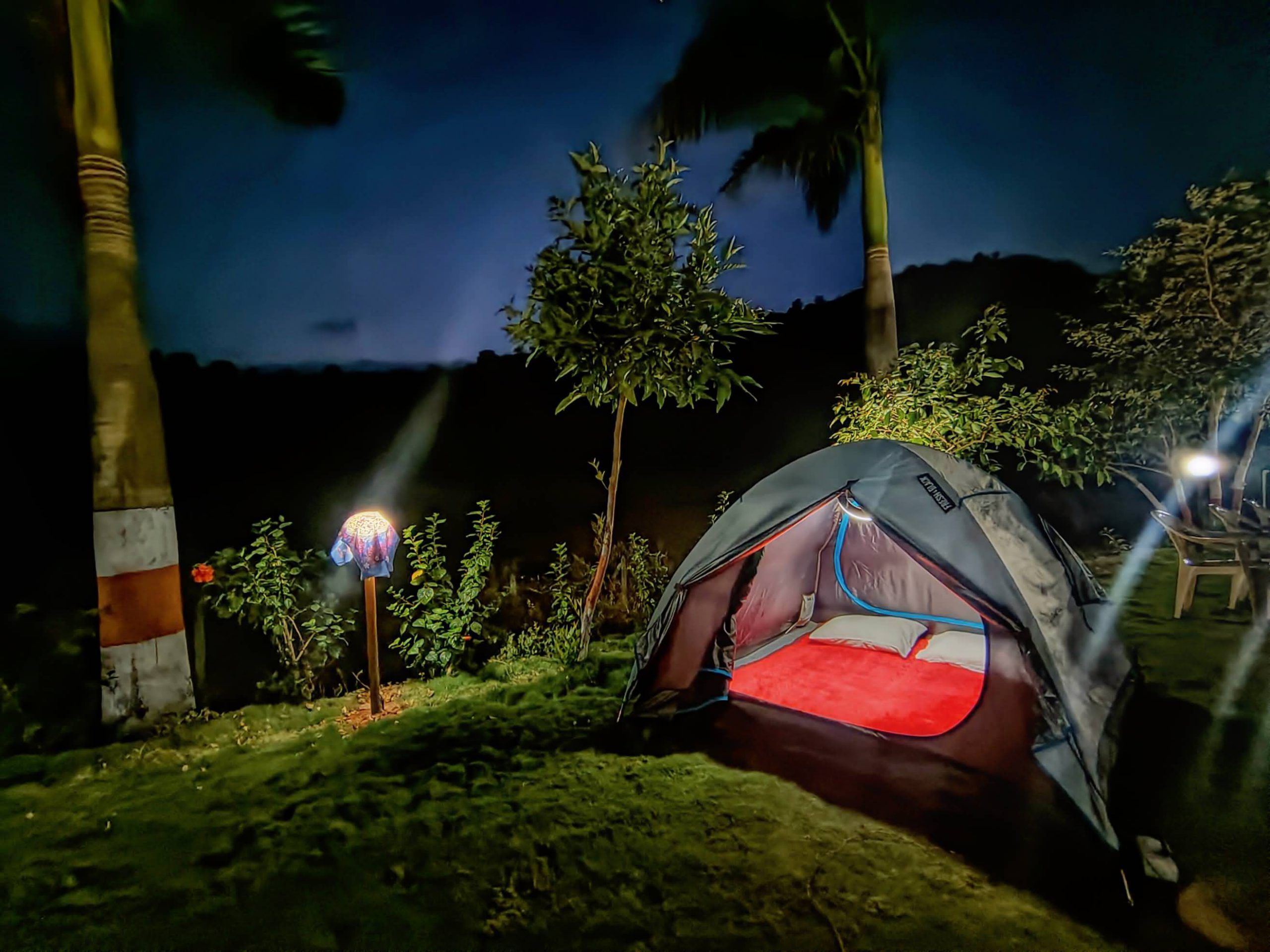 Tent camping at night in HAVE Villas JMD Farm in Pawna Lake, Lonavala