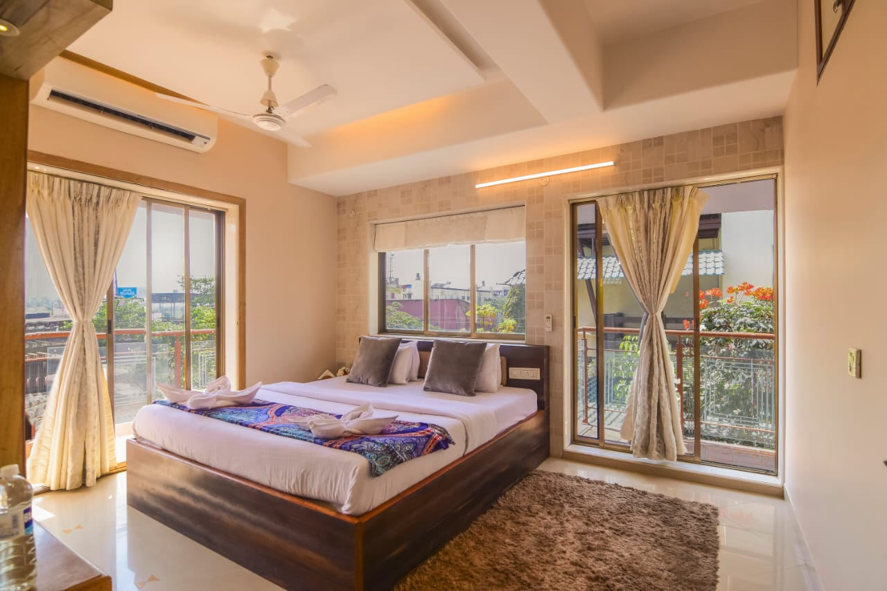 Bedroom with Balcony view