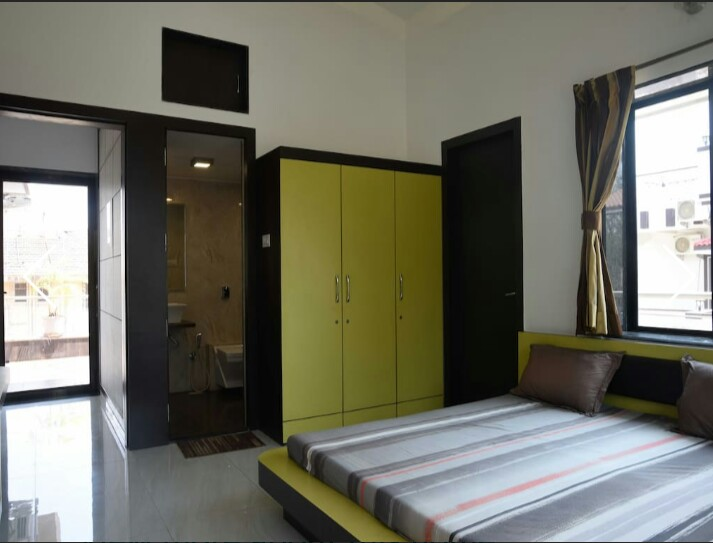 Bedroom with attached bathroom & balcony